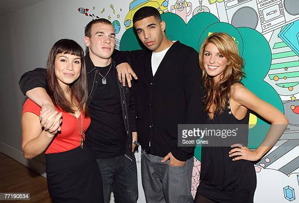 DeGrassi High cast members Cassie Steele Shane Kippel Aubrey Graham and Shenae Grimes pose for a photo backstage during MTV's Total Request Live at...