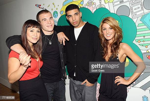 'DeGrassi High' cast members Cassie Steele Shane Kippel Aubrey Graham and Shenae Grimes pose for a photo backstage during MTV's Total Request Live at...