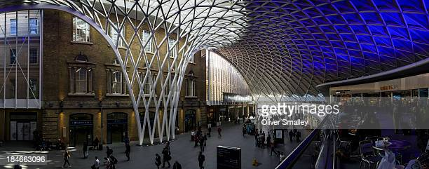 Degree panorama of the newly renovated Kings Cross Station in London, England. The extravagant interior design makes the every-day commute a more...