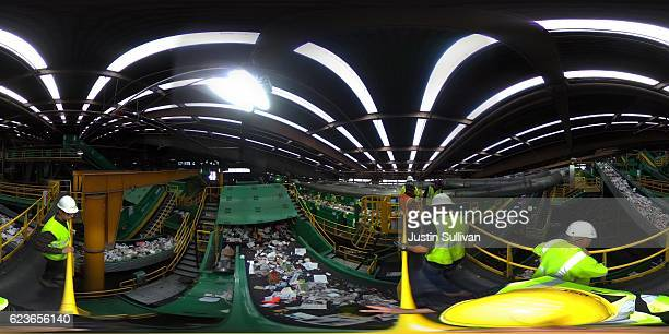 A 360 degree view as workers sort recyclable materials as they pass through a sorting machine at Recology's Recylce Central on November 16 2016 in...