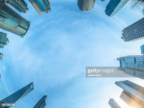360 degree view of modern skyscrapers against sky - image stock pictures, royalty-free photos & images