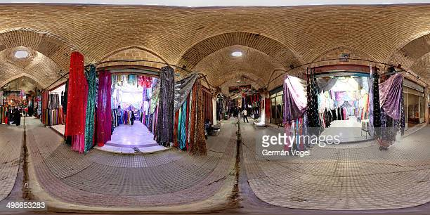 Degrees wide angle view of the textiles section inside the brick vaulted bazar market of Kermanshah, a straight glimpse into the heart of the silk...