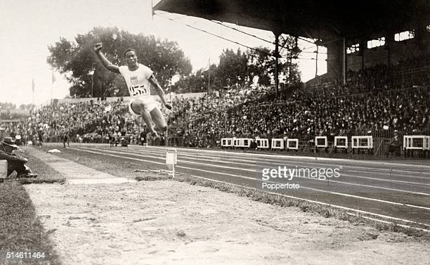 DeHart Hubbard of the United States enroute to winning the gold medal in the men's running long jump at the Summer Olympic Games in Paris, circa...