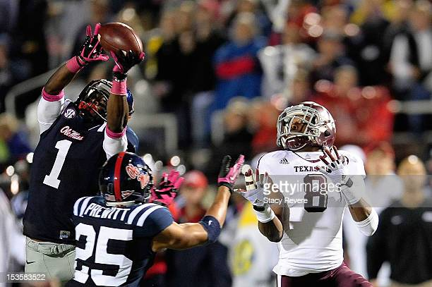 Dehendret Colins of the Ole Miss Rebels intercepts a pass intended for Thomas Johnson of the Texas AM Aggies during a game at VaughtHemingway Stadium...