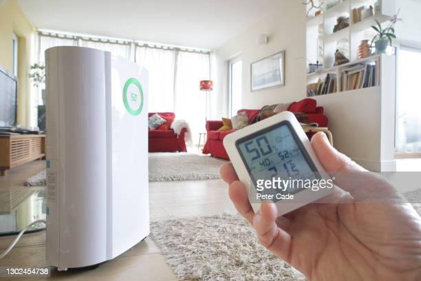 dehumidifier and energy monitor in home - humid stock pictures, royalty-free photos & images