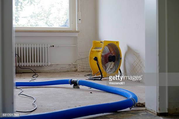 Dehumidifier at work in an apartment which is damaged by flooding