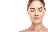 Dehydration effect. Portrait of young attractive woman with closed eyes, cracked and damaged face against white background. Skin Care concept.