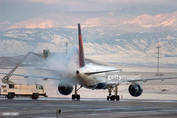 Deicing airplane during winter Denver Colorado
