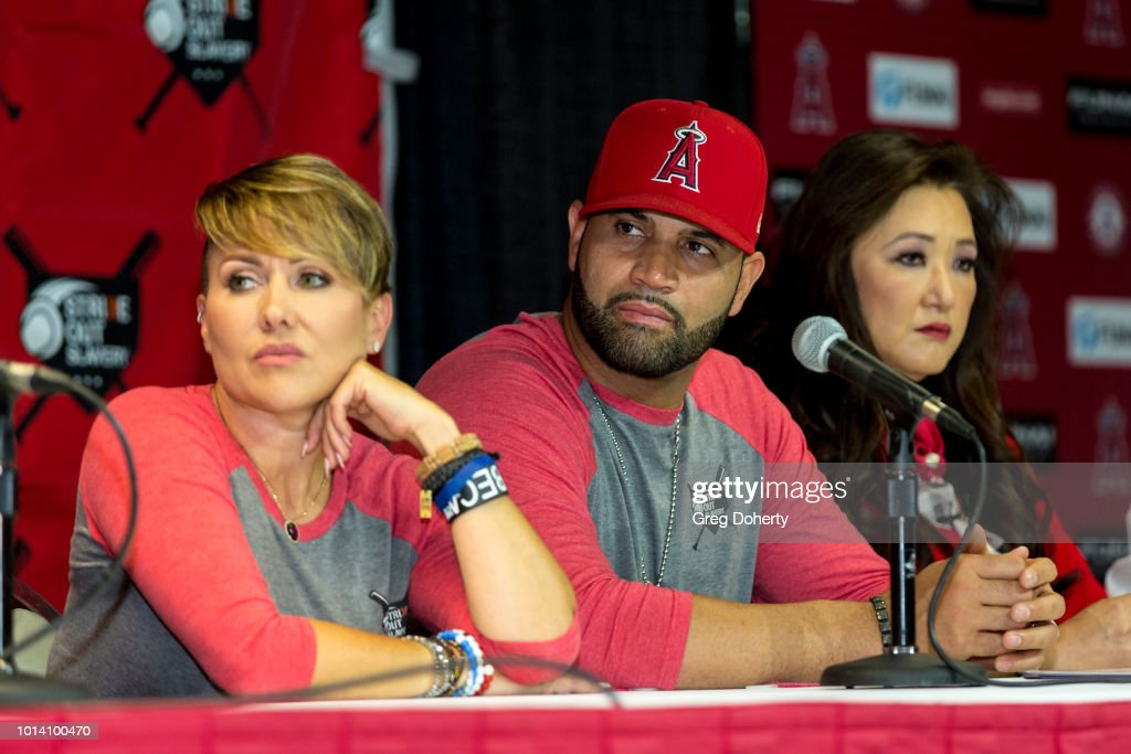Deidre Pujols, Albert Pujols and Susan Kang Schroeder attend the Strike Out Slavery Press Conference at Angel Stadium on August 9, 2018 in Anaheim, California.