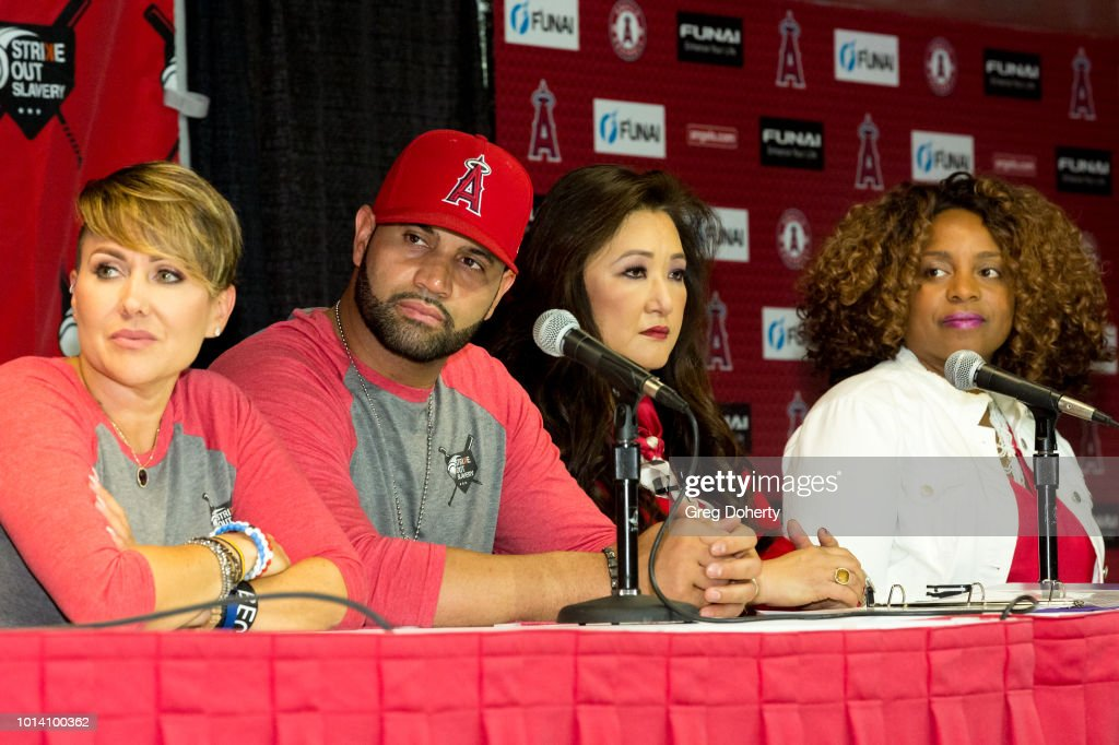 Deidre Pujols, Albert Pujols, Susan Kang Schroeder and Survivor Advocate Stacy Jewell attend the Strike Out Slavery Press Conference at Angel Stadium on August 9, 2018 in Anaheim, California.