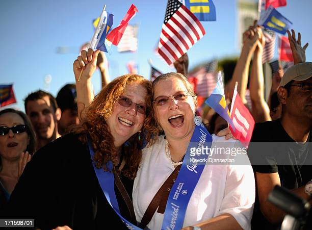 Deidre Weaver and her partner Nancy Grass celebrate the US Supreme Court ruling during a community rally on June 26 2013 in West Hollywood California...