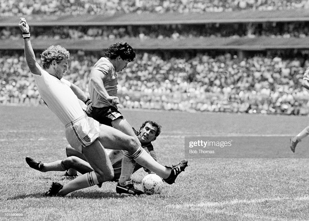 Deigo Maradona of Argentina (centre) goes past Terry Butcher (left) and goalkeeper Peter Shilton of England as he scores Argentina's second goal during a World Cup Quarter-Final match held at the Azteca Stadium, Mexico City on 22nd June 1986. Argentina beat England 2-1. (Bob Thomas/Getty Images).