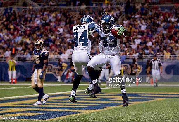Deion Branch and Bobby Engram both of the Seattle Seahawks celebrate Branch's touchdown against the St Louis Rams at the Edward Jones Dome November...