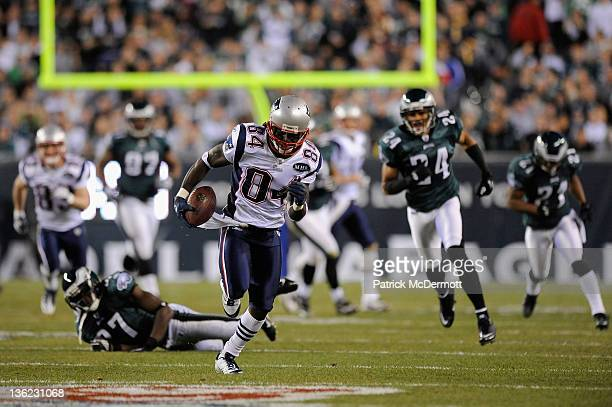 Deion Branch of the New England Patriots catches a 63yard reception in the second quarter against Brandon Hughes and Nnamdi Asomugha of the...