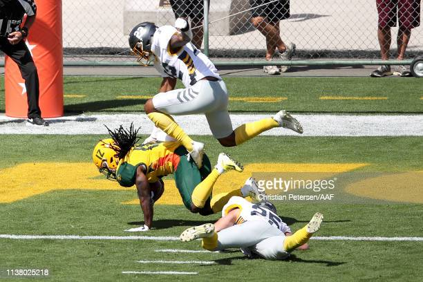 Deion Holliman of the Arizona Hotshots scores a touchdown past Jordan Martin and Ryan Moeller of the San Diego Fleet during the first half of the...