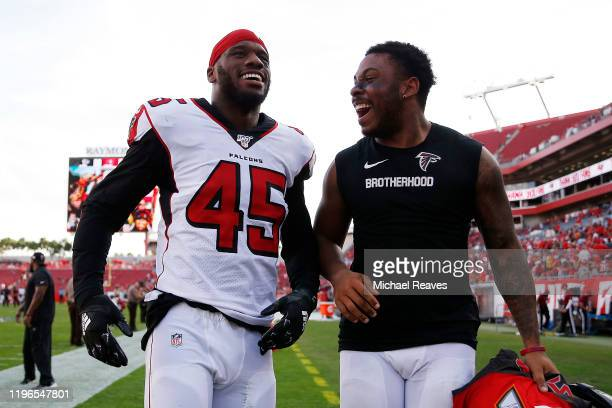 Deion Jones of the Atlanta Falcons celebrates after intercepting Jameis Winston of the Tampa Bay Buccaneers and returning it for a touchdown to...