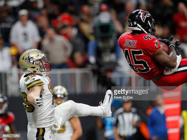 Deion Jones of the Atlanta Falcons intercepts a touchdown pass intended for Willie Snead of the New Orleans Saints at MercedesBenz Stadium on...