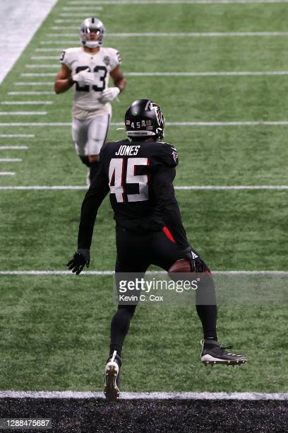 Deion Jones of the Atlanta Falcons scores a touchdown after intercepting a pass by Derek Carr of the Las Vegas Raiders during their NFL game at...