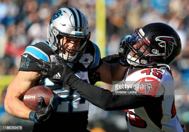 Deion Jones of the Atlanta Falcons tries to stop Christian McCaffrey of the Carolina Panthers during their game at Bank of America Stadium on...