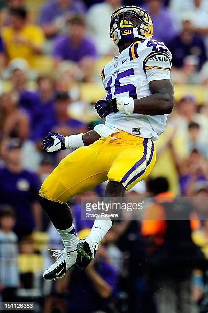 Deion Jones of the LSU Tigers celebrates a tackle behind the line during a game against the North Texas Mean Green at Tiger Stadium on September 1...