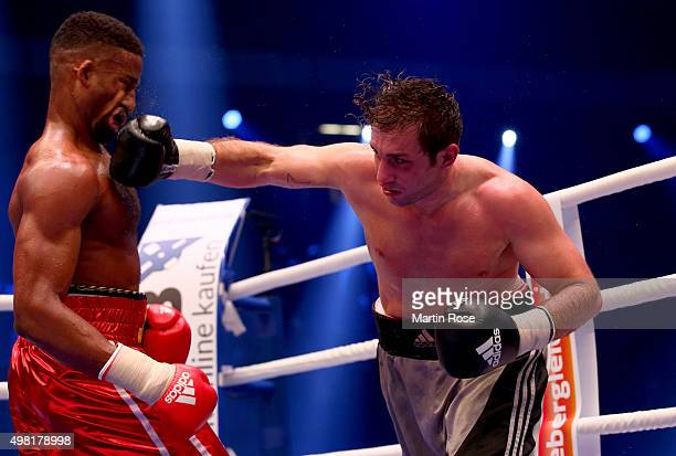 Deion Jumah of Great Britain exchange punches with Fabrizio Leone of Italy during their light heavy weight fight at TUI Arena on November 21, 2015 in...