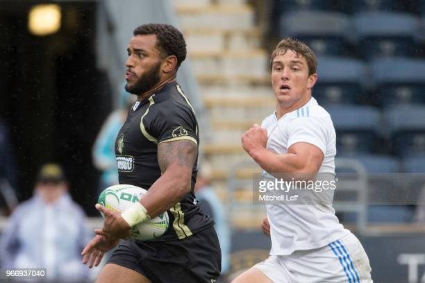 Deion Mikesell of Lindenwood runs past Benjamin Broselle of UCLA in the championship game during day 2 of the Penn Mutual Collegiate Rugby...
