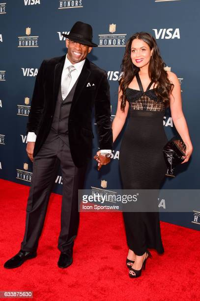 Deion Sanders and his wife pause for photos during the NFL Honors Red Carpet on February 4 2017 at the Worthan Theater Center Houston Texas