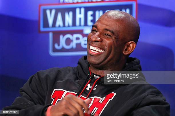 Deion Sanders looks on after being inducted into the 2011 Pro Football Hall of Fame class during an announcement at the Super Bowl XLV media center...