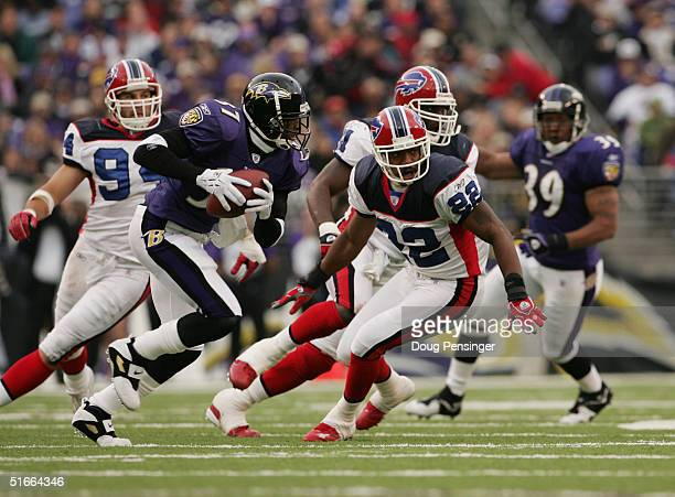 e53a87751 Deion Sanders of the Baltimore Ravens runs the ball against the Buffalo  Bills during their game