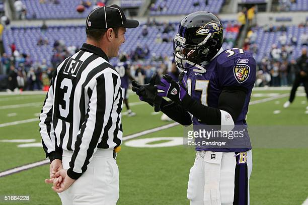 e4652cec4 Deion Sanders of the Baltimore Ravens talks with NFL Field Judge Scott  Edwards prior to taking. Buffalo Bills ...