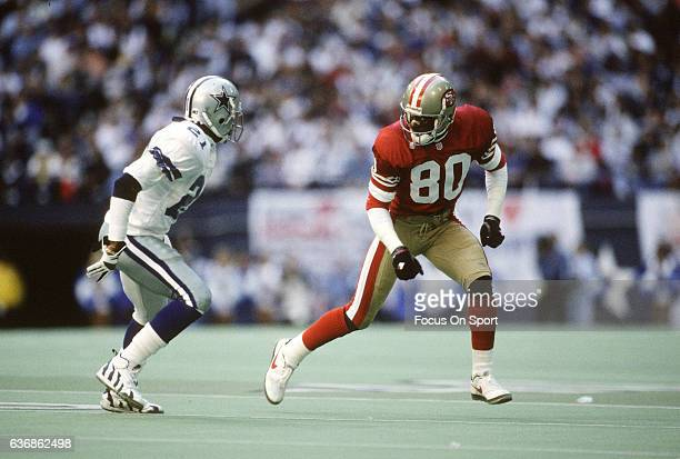 https://media.gettyimages.com/photos/deion-sanders-of-the-dallas-cowboys-in-action-against-jerry-rice-of-picture-id636862498?s=612x612