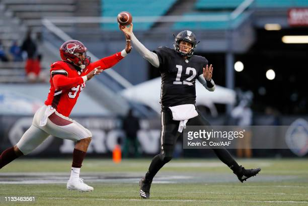 Deion Barnes of the San Antonio Commanders attempts to block a pass by Luis Perez of the Birmingham Iron during the second half in an Alliance of...