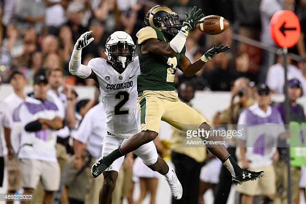 Deionte Gaines of the Colorado State Rams makes a catch as Ken Crawley of the Colorado Buffaloes defends during the second half of the Buffs' 2724...