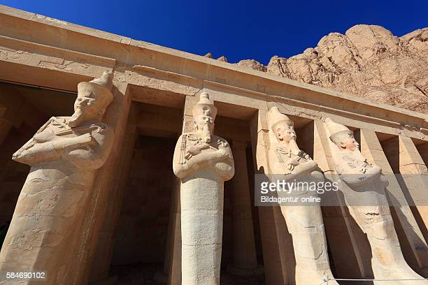 Deir elBahari or Dayr alBahri Part of the temple statues at the mortuary temple of Hatshepsut Egypt