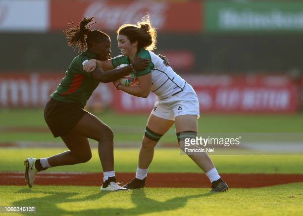 Deirbhile Nic A Bhaird of Ireland is tackled by Jenet Okelo of Kenya on day one of the Emirates Dubai Rugby Sevens HSBC World Rugby Sevens Series at...