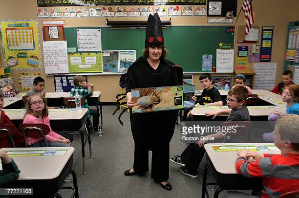 Deirdre Arvidson Public Health Nurse with the Barnstable County Dept of Health Environment dressed in a giant tick costume talks with third graders...