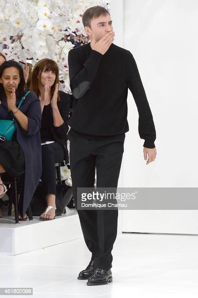 Deisgner Raf Simons acknowledges the applause of the public following the Christian Dior show as part of Paris Fashion Week Haute Couture Fall/Winter...