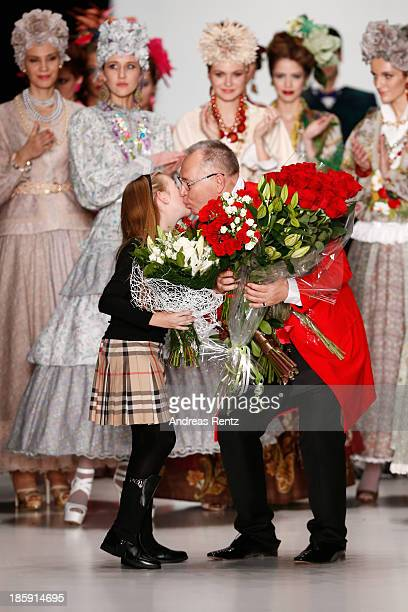 Deisgner Slava Zaitsev receives flowers after the SLAVA ZAITSEV PretAporter De Luxe show during MercedesBenz Fashion Week Russia S/S 2014 on October...
