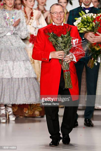 Deisgner Slava Zaitsev receives flowers and walks the runway after the SLAVA ZAITSEV PretAporter De Luxe show during MercedesBenz Fashion Week Russia...