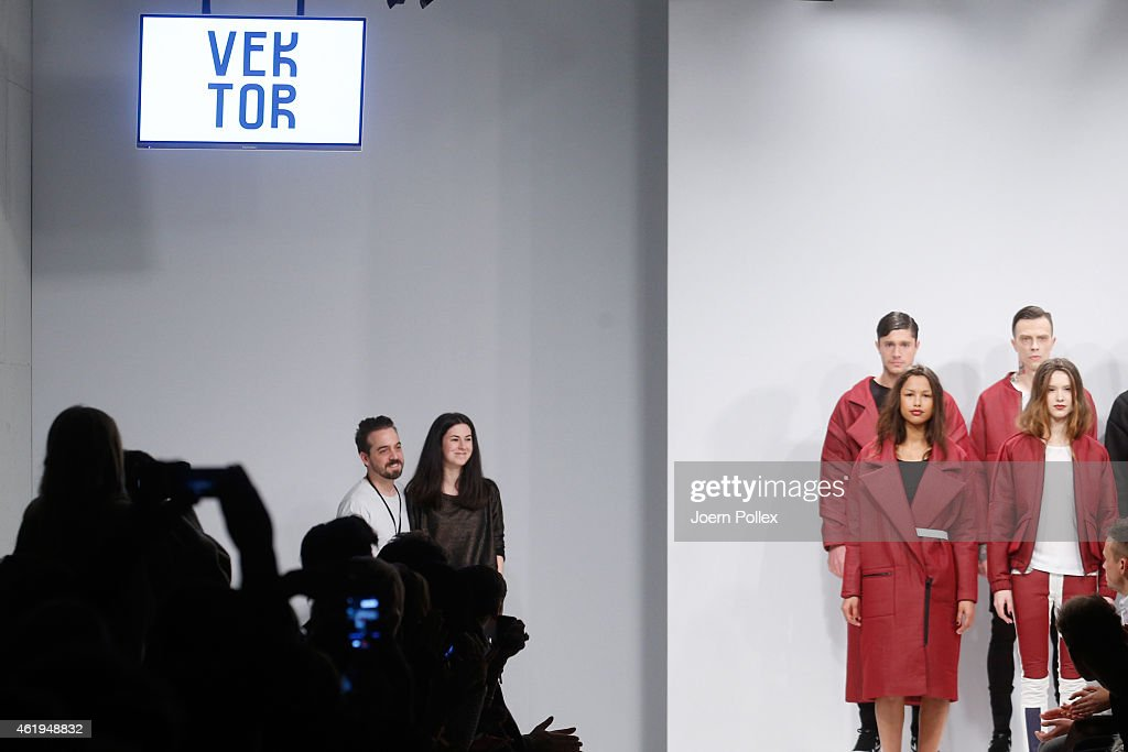 Deisgners Martin Eichler (L) and Kristina Puljan pose on the runway at the Vektor show during the Mercedes-Benz Fashion Week Berlin Autumn/Winter 2015/16 at Brandenburg Gate on January 22, 2015 in Berlin, Germany.