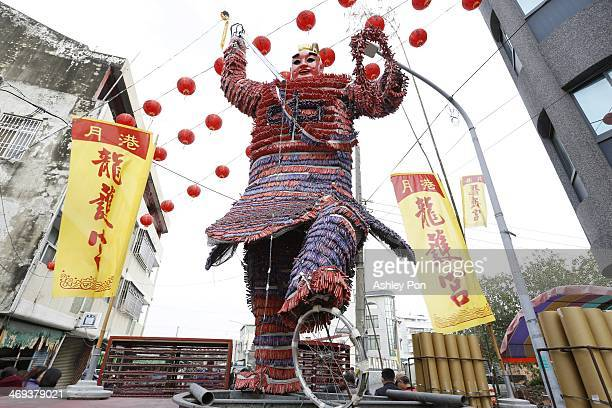 Deity statue tied with tons of fireworks is displayed during the annual Yanshuei Beehive Rockets Fireworks Festival on February 14, 2014 in Tainan,...