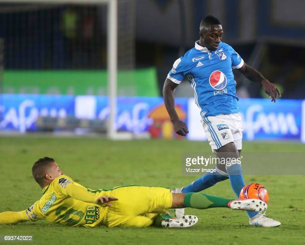 Deiver Machado of Millonarios fights for the ball with Mateus Uribe of Atletico Nacional during the Semi Finals first leg match between Millonarios...