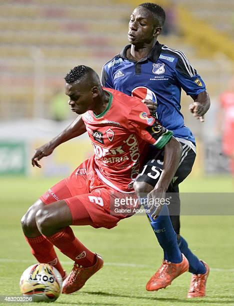 Deiver Machado of Millonarios struggles for the ball with Jesus Murillo of Patriotas FC during a match between Patriotas FC and Millonarios as part...