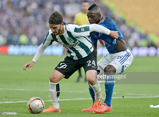 Deiver Machado of Millonarios struggles for the ball with Sebastian Perez of Atletico Nacional during a match between Millonarios and Atletico...