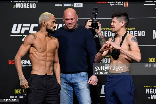 Deiveson Figueiredo of Brazil and Brandon Moreno of Mexico face off during the UFC 256 weigh-in at UFC APEX on December 11, 2020 in Las Vegas, Nevada.