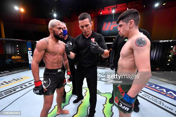 Deiveson Figueiredo of Brazil and Brandon Moreno of Mexico face off prior to their flyweight championship bout during the UFC 256 event at UFC APEX...
