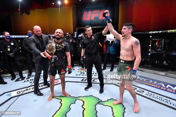 Deiveson Figueiredo of Brazil and Brandon Moreno of Mexico react after their flyweight championship bout was declared a majority draw during the UFC...
