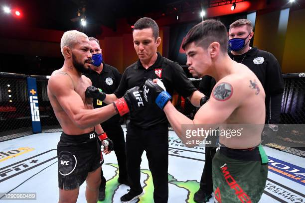 Deiveson Figueiredo of Brazil and Brandon Moreno of Mexico touch gloves prior to their flyweight championship bout during the UFC 256 event at UFC...