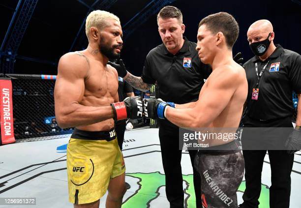 Deiveson Figueiredo of Brazil and Joseph Benavidez face off prior to their UFC flyweight championship bout during the UFC Fight Night event inside...