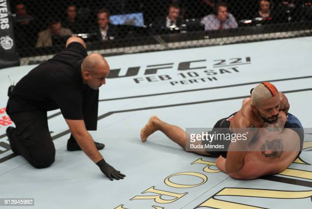 Deiveson Figueiredo of Brazil attempts to submit Joseph Morales in their flyweight bout during the UFC Fight Night event at Mangueirinho Arena on...
